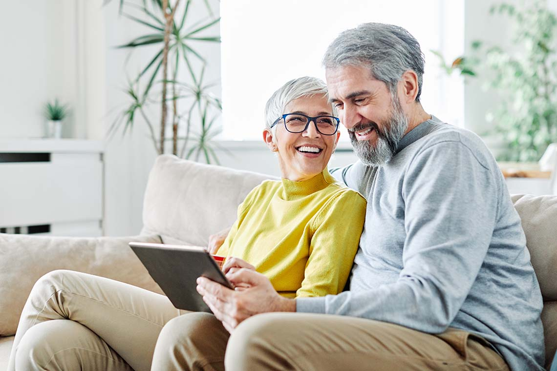 older couple enjoying tech-savvy gifts for grandparents