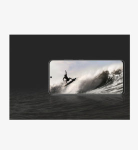 photo of guy surfing on galaxy s21 ultra 5g